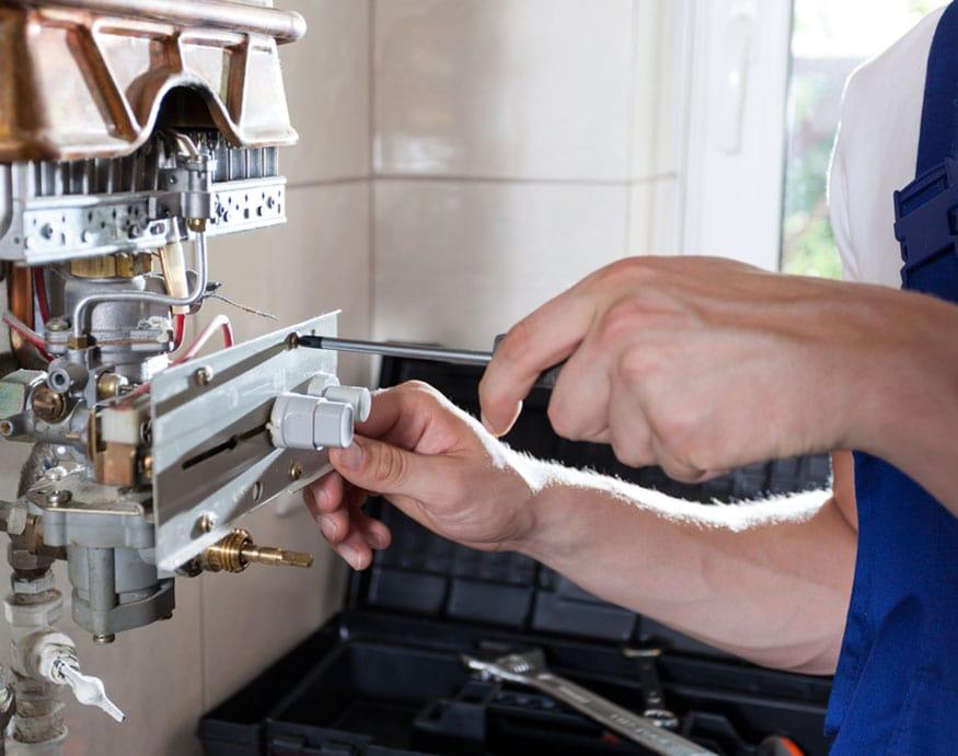 plumber fixing a faulty pressure balancing valve