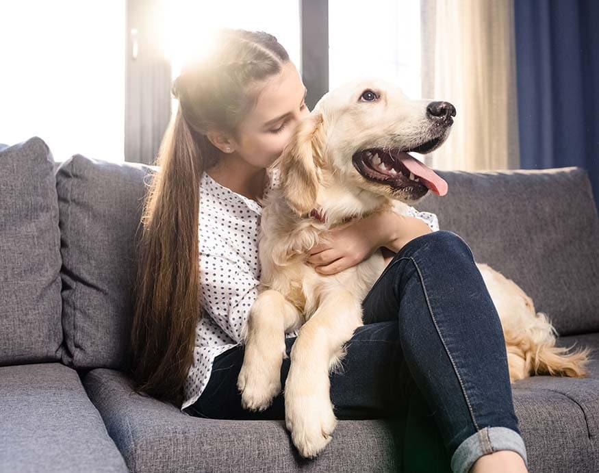 A girl hugging his dog